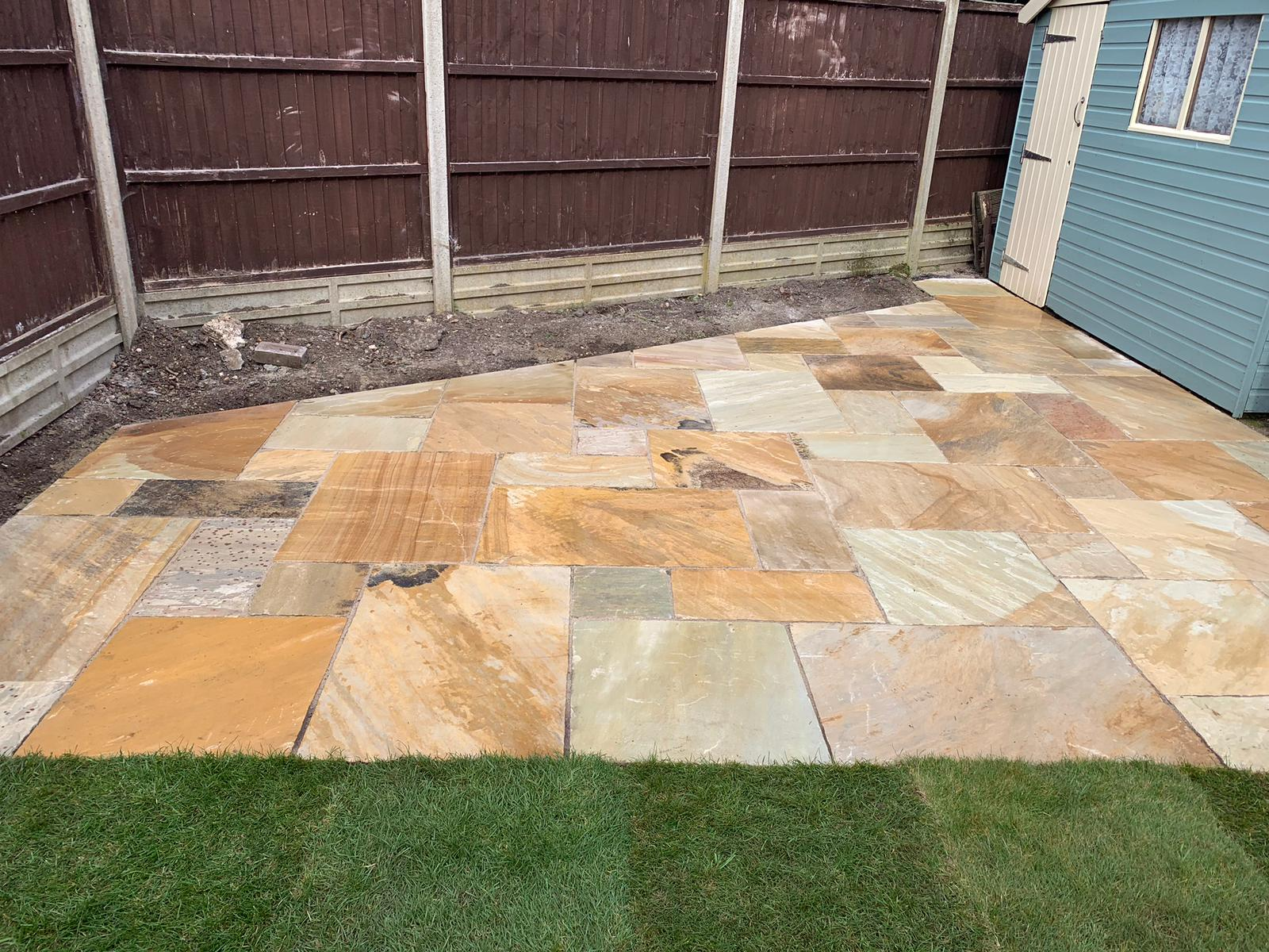 Indian sandstone paving for a patio in st albans