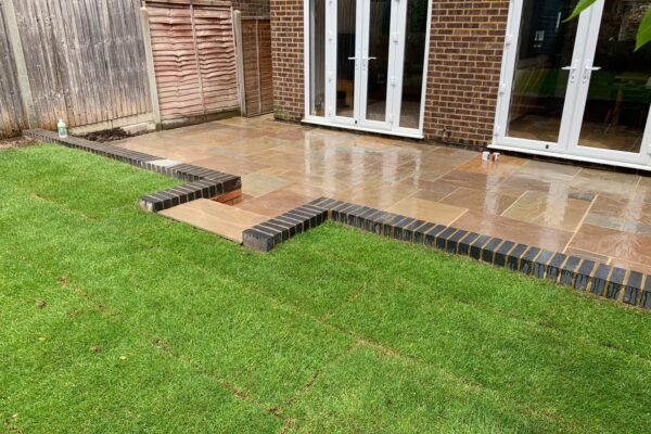 sandstone patio laid with new lawn